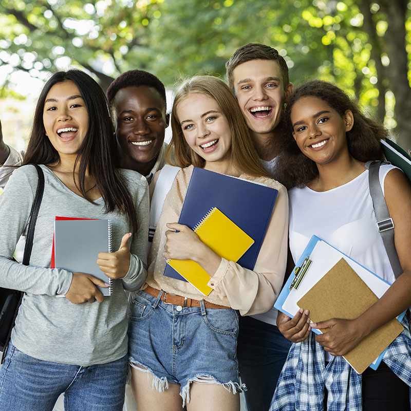 Partners4Wellness - Group of young adult holding folders in a school campus